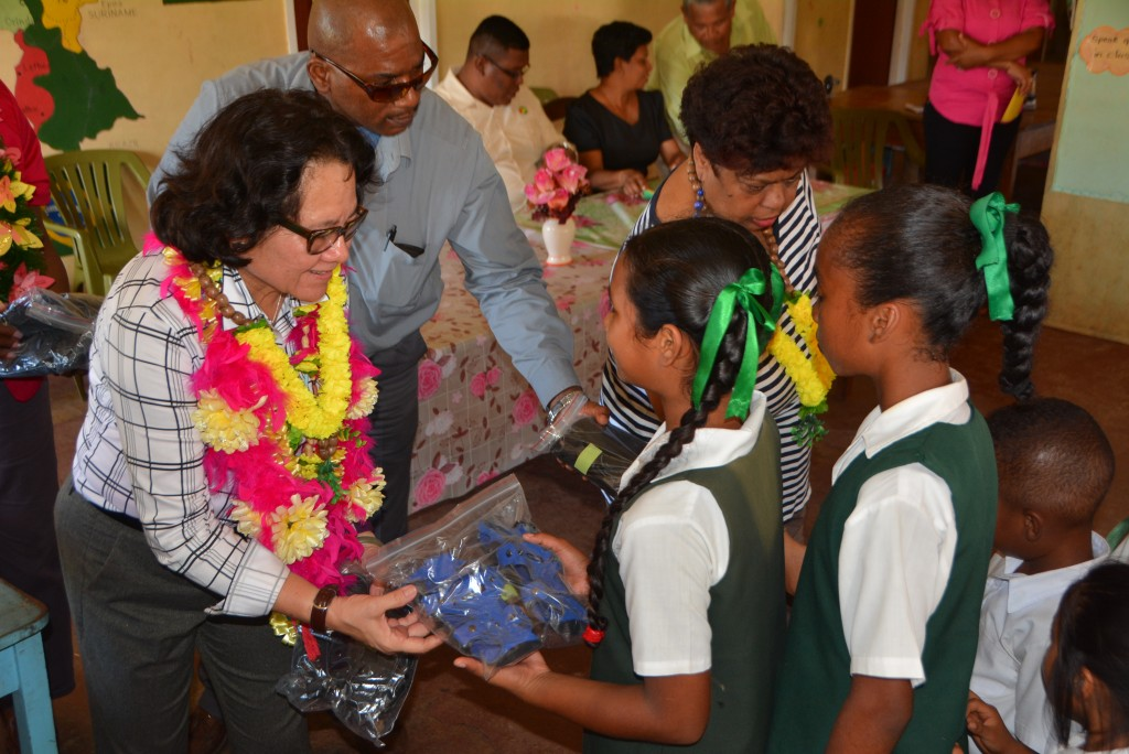 First Lady, Sandra Granger, distributes shoes to the students of Barabina Primary School.