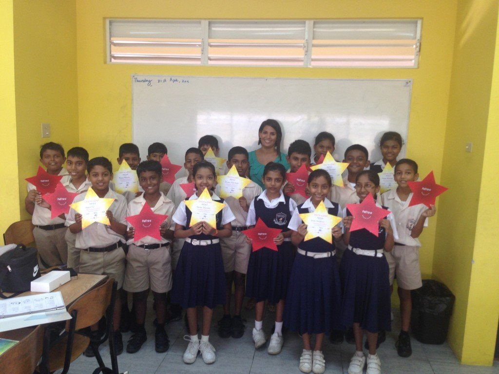 Project Happiness Regional Director, Amanda Fernandes, with the programmes most recent graduates.